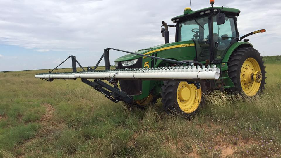 John Deere tractor with a WickMaster ropewick attachment